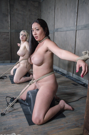 Best friends Nadia White  Nyssa Nevers get tortured together in a dungeon