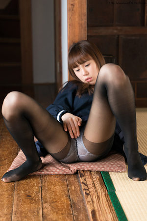 Young Asian schoolgirl pulling down her black pantyhose to masturbate