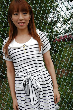 Asian Chihiro Ozawa is walking in her sexy striped dress outdoors