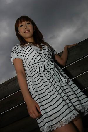 Asian Chihiro Ozawa is walking in her sexy striped dress outdoors