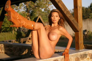 Big boobed MILF Tera Patrick displays her twat in leather gloves and boots