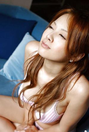 Bosomy asian babe with puffy nipples Yuka Hata slipping off her lingerie