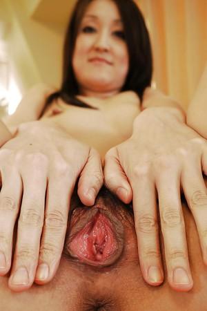 Asian babe Rikp Kariya stripping to expose white panties and panties